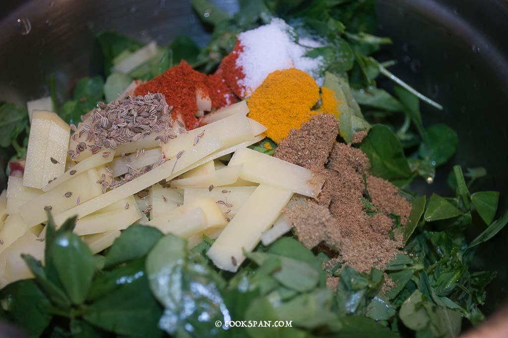 Adding the Powdered spices to the pakodas
